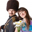 Youth man in military and his girlfriend with flowers. — Stock Photo