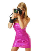 Pretty woman photographing with a big camera — 图库照片
