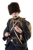 Russian Cossack inspecting a poniard. The living history. — Stock Photo