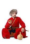 Tatar warrior sitting with cup and calabash. — Stock Photo