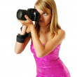 Pretty woman photographing with a big camera — Stock Photo