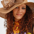 Stock Photo: Frizzy girl in hat wide-brimmed.