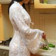 Sexy woman cooking in the kitchen. — Foto de Stock   #10914934