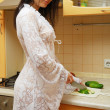 Sexy woman cooking in the kitchen. — Stock Photo #10914995
