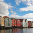 Many-colored houses on piles over the river in Trondheim. — Stock Photo