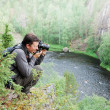 Man photographing on the top of taiga forest. — Stock Photo