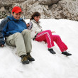 Tourists sliding on snowfield. — Stock Photo #10959785