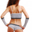 Rear view of frizzy girl in polka dot clothes. — Stock Photo