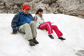 Tourists sliding on snowfield. — Stock Photo