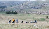 Tourists making a halt on tableland. — Stock Photo
