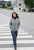 Happy woman on the pedestrian crossing — Stock Photo