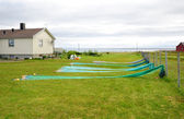 Norwegian yard with small house and fishing nets. — Stock Photo