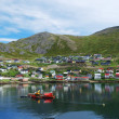 Green hill with fishing town on the side of fjord, Mageroya. — Stock Photo
