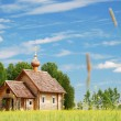 Finnish landscape with small wooden church. — Stock Photo