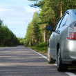 Car on Finnish road in the forest — Stock Photo