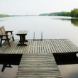 Lake with small wooden platform for rest — Stock Photo #11151992