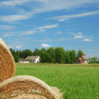 Finnish landscape with straw, farm and country church — Stock Photo
