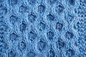 Close-up of knitted cloth with raised tracery — Stock Photo
