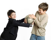 Two boys playing with football isolated on white — Stock Photo