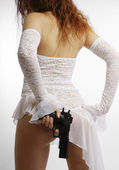 Woman in white with gun, rear view — Stock Photo