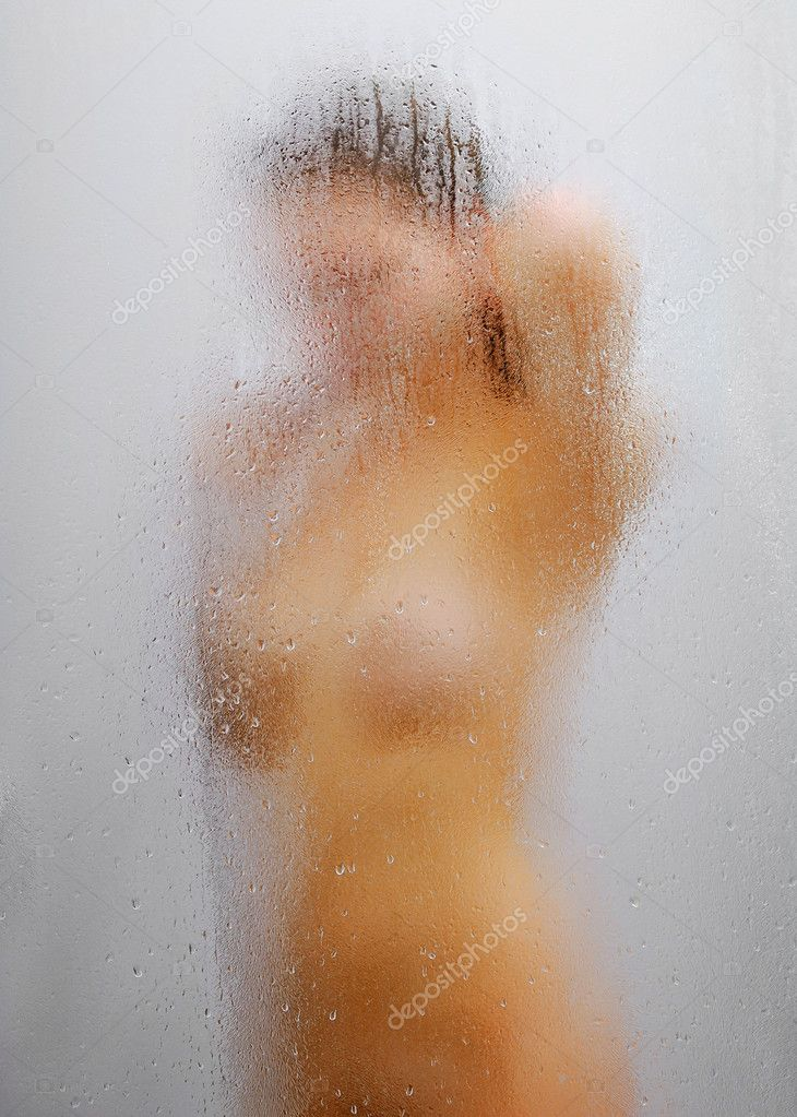 Nude girl in shower through glass with drops of water — Stock Photo #11203086