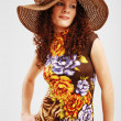 Stock Photo: Pretty girl in summer dress and broad-brim