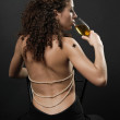 Rear view of sexy girl drinking wine — Stock Photo