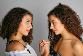 Portrait of twins face to face — Stock Photo