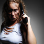 Serious woman with handgun — Stock Photo #11428427