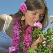 Beautiful girl smelling a rose — Stock Photo