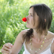 Woman holding a poppy — Stock Photo
