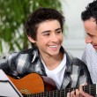 Stock Photo: Guitar lesson