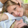 Closeup of lovers in the grass — Stock Photo