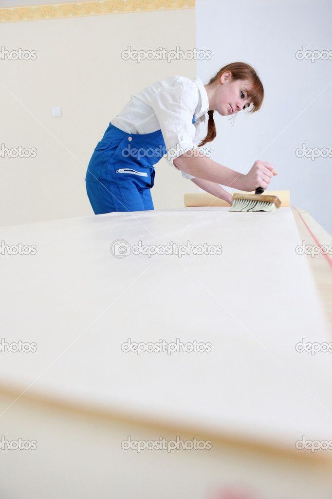 Woman pasting wallpaper  Stock Photo #10829466
