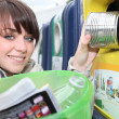 Woman recycling household waste -  