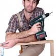 Man with hand drill — Stock Photo