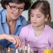 Mother daughter chess match — Stock Photo #10830546