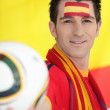 Man supporting the Spanish soccer team - Stock Photo