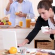 Couple eating breakfast before work — Stock Photo