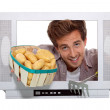Boy with basket of potatoes behind television frame - Stock Photo