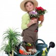 Little girl with plants — Stock Photo #10833632