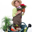 Stock Photo: Little girl with plants