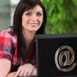 Brunette woman with computer — Stock Photo #10834241