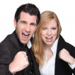 Business couple with their fists in the air — Stock Photo