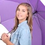 Teenage girl holding purple umbrella — Stock Photo #10835519