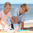 Children playing at the beach - Stock Photo