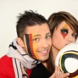German couple supporting their national football team - Stock Photo