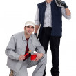 A team of tradesmen posing with their tools — Stock Photo #10836579