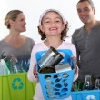 Girl and parents recycling — Stock Photo