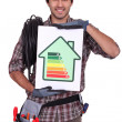 Stock Photo: Electrician with an energy rating card